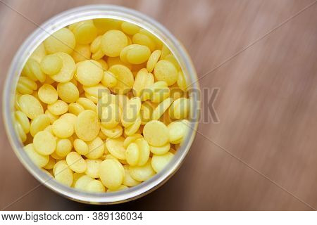 Wax Beans In Box For Hair Removal. Pearl Wax For Depilation Woman Legs Or Bikini Areas. Allergen Fre