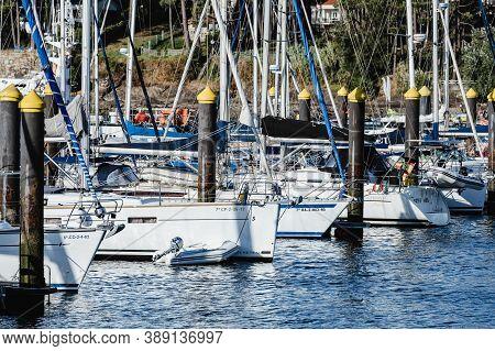 Portonovo, Spain - August 15, 2020: Small Sailing Boats Moored In The Yacht Club Of Portonovo On A C