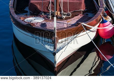 Small Sailing Boat Moored In The Yacht Club Of Portonovo On A Clear Summer Day, Pontevedra, Spain.