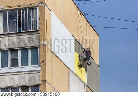 Tula, Russia - October 10, 2020: Industrial Climber Worker Applying Additional Styrofoam Insulation