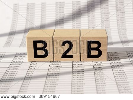 B2b Acronym On Wooden Blocks. Business To Business Concept On Financial Documents.