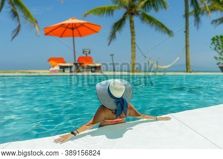 woman in luxury five stars  spa tropical resort in the swimming pool.