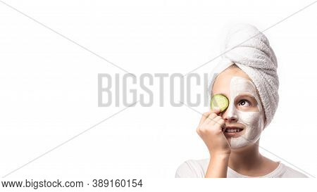 Girl Making Clay Facial Mask And And Cucumber On Eyes. Teenage Girl Doing Anti Blemish Skin Treatmen