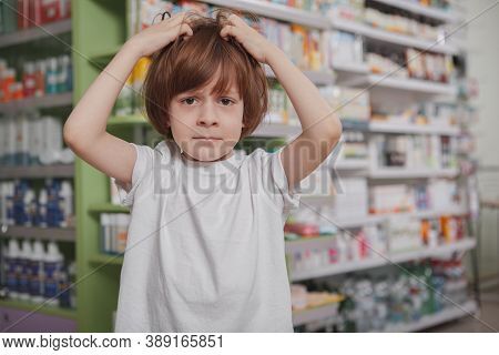 Little Boy Scratching His Head, Having Lice, Copy Space. Little Schoolboy With Lice In His Hair, Scr