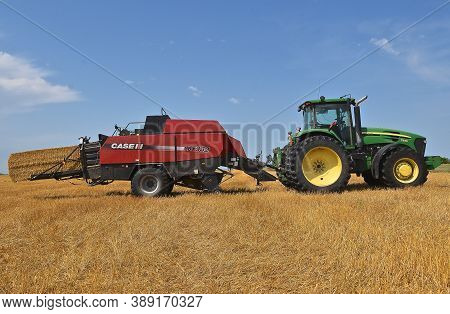 Huron, South Dakota, August 7, 2020: The Case Ih Lbx332 Baler Ready To Emit A New Bale Of Straw Is A