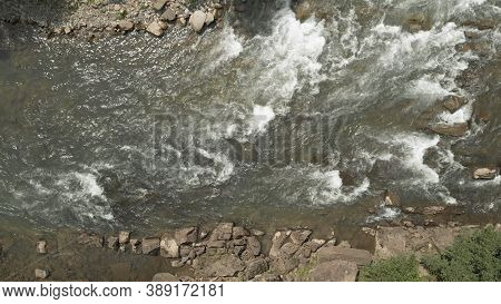 Seething Flows Of Clear Water In The River. Topview Of Fresh Water Of Mountain Stream.
