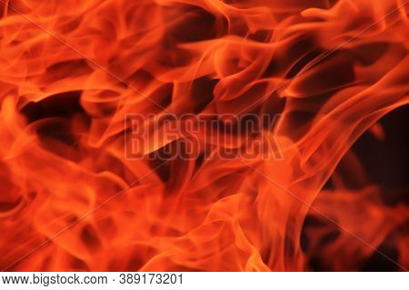Hot Red Flame On Black Background Photo