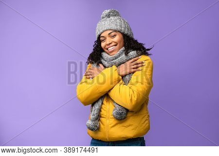 Winter Clothing. Happy African American Woman Wearing Warm Jacket, Cap And Scarf Standing Posing In