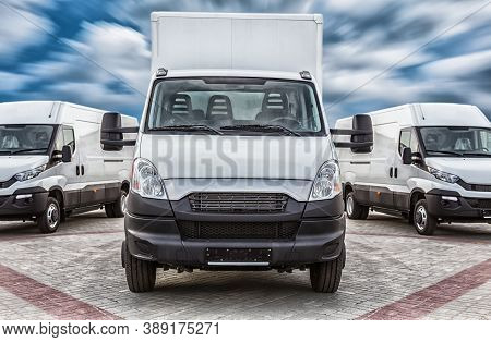 Transport Truck And Minivans Cargo Delivery Photo