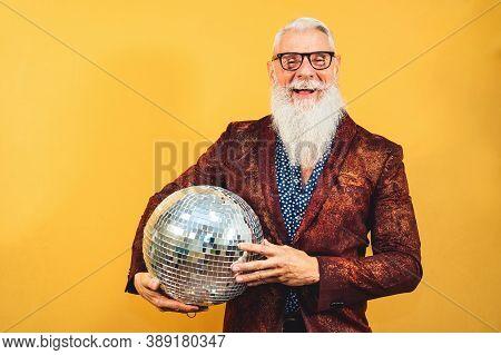 Senior Fashion Man Celebrating New Year's Eve In Disco Club