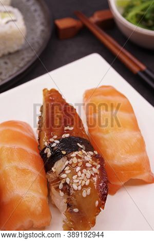 Japanese Sushi Food On A White Plate. Salmon Nigiri, Unagi Nigiri