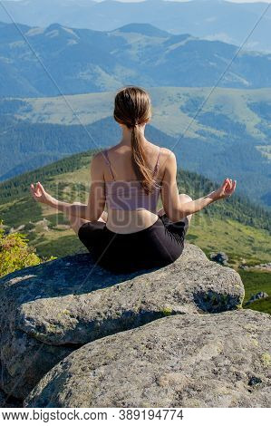 Yoga, Meditation. Woman Balanced, Practicing Meditation And Zen Energy Yoga In Mountains. Woman Doin
