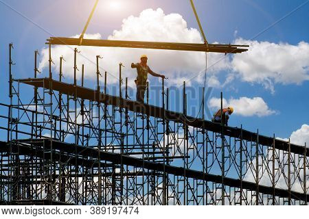 Man Working On Construction Site With Scaffold And Building With Sky Background,scaffolding For Cons