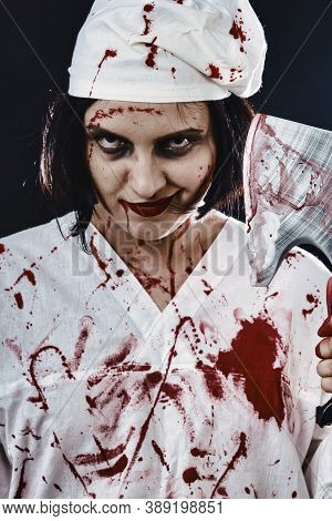 Gloomy Bloody Woman Doctor With An Ax On A Black Background Smiling