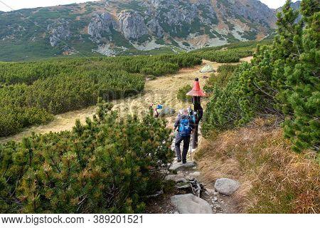 Vysoke Tatry, Slovakia - October 10, 2018: Hikers On Trail At Great Cold Valley,  Vysoke Tatry (high