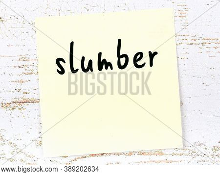 Concept Of Reminder About Slumber. Yellow Sticky Sheet Of Paper On Wooden Wall With Inscription