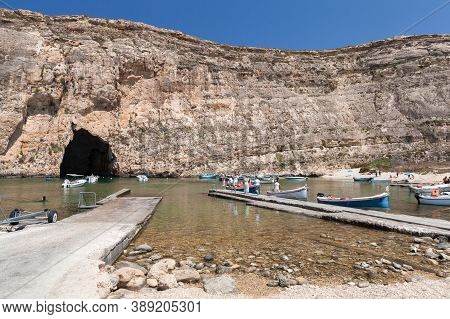 Gozo, Malta - August 26, 2019: Inland Sea Divesite, Tourists Explore Caves On Boats
