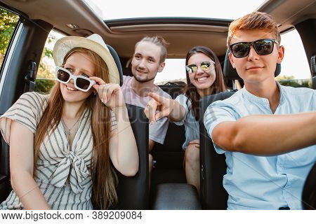 Group Of Friends In Car. Road Trip Concept. Summer Vacation