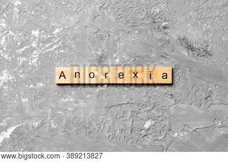 Anorexia Word Written On Wood Block. Anorexia Text On Table, Concept