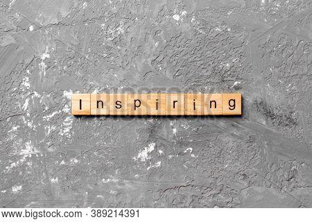 Inspiring Word Written On Wood Block. Inspiring Text On Table, Concept