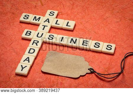 small business Saturday - crossword and blank price tag, holiday shopping concept