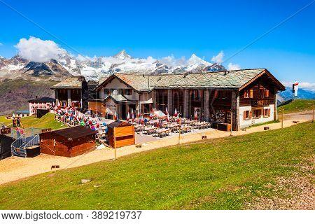 Zermatt, Switzerland - July 16, 2019: Cable Car Station And Street Cafe Located Near Zermatt Town In