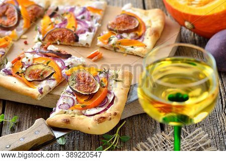 Tarte Flambee From Alsace With Goat's Cream Cheese, Onions, Slices Of Pumpkins And Figs, Served With