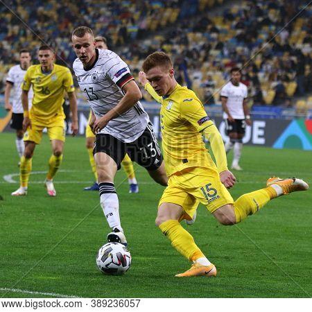 Kyiv, Ukraine - October 10, 2020: Viktor Tsygankov Of Ukraine (r) Controls A Ball During The Uefa Na