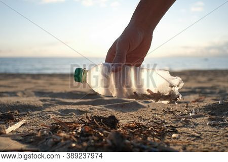 Man Volunteer Collect Plastic Bottle On Dirty Sea Ecosystem, Environmental Contaminated Pollution
