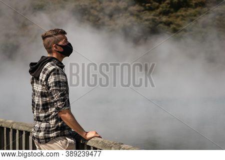 Caucasian Young Man Wearing Face Mask Visiting City With Hot Springs. Rotorua, New Zealand