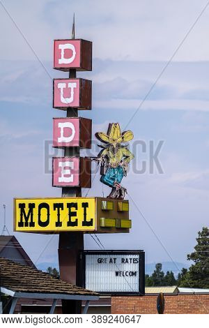 West Yellowstone, Montana - September 24, 2020: Retro Neon Sign For Dude Motel In The Tourist Town