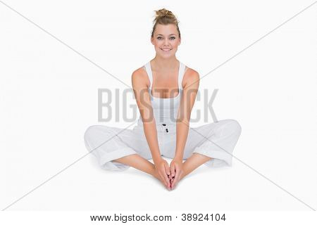 Smiling girl sitting in bound angle yoga pose