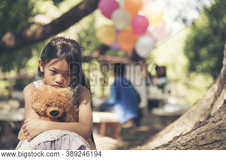 Sad Girl Hugging Teddy Bear Sadness Alone In Green Garden Park. Lonely Girl Feeling Sad Unhappy Sitt