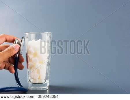 Hand Of Doctor Hold Stethoscope Check On Glass Full Of White Sugar Cube Sweet Food Ingredient, Isola