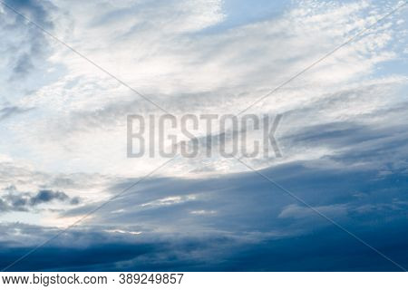 Blue Sky With White Clouds. Background From The Cloudy Sky. Long And Stretched Clouds In The Sky.blu