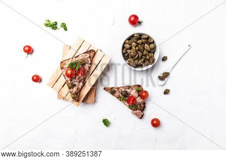 Appetizer Bruschetta With Tuna, Capers And Tomatoes On Wholemeal Bread. Italian Cuisine, Delicious B