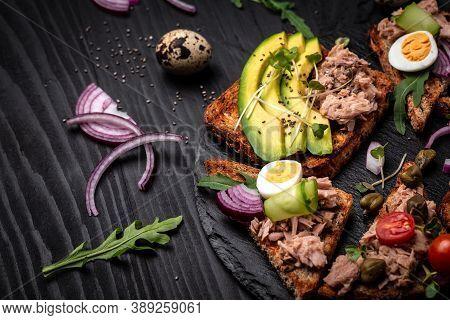 Sandwich Tuna Fish Salad On Wholemeal Bread On Wooden Background. Italian Cuisine, Delicious Breakfa