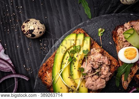 Tuna Sandwiches With Avocado And Microgreen On Wholemeal Bread, Wooden Background. Tasty Tuna Sandwi
