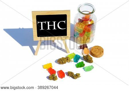 THC  Candies. CBD Edibles. Gummy Bear Candies filled with CBD or THC. Isolated on white. Room for text. Chalk Board Reads THC.