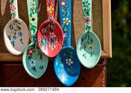 Many Hand Made Painted Wooden Spoons With Traditional Decorations Displayed For Sale As Souvenirs At