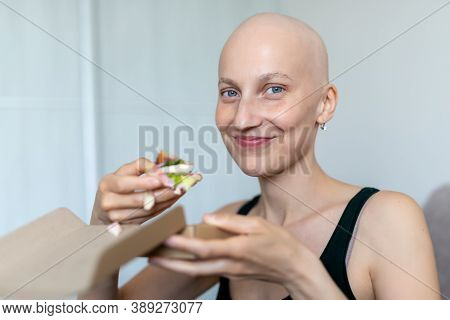 Young Adult Beautiful Caucasian Bald Shaved Hair Woman Portrait Enjoy Eating Sandwich For Lunch At H