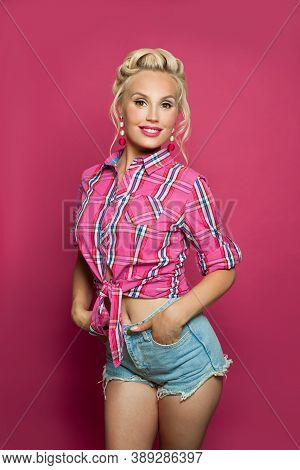 Beautiful Pin-up Woman Standing On Pink Background