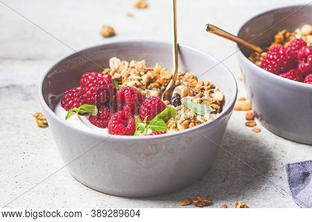 Muesli With Raspberries And Yoghurt In A Gray Bowl. Healthy Food Concept.