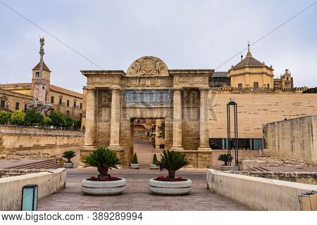 Cordoba, Spain - October 31, 2019: Puerta Del Puente Gate, Arch Of Triumph And Cathedral Mosque In C
