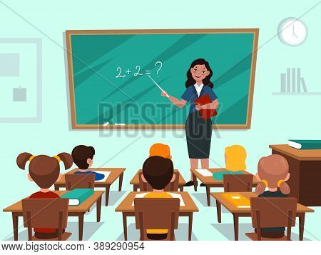 Students In Classroom. Teacher Near Blackboard In Auditorium Teaches Maths Lesson, Children Study Su