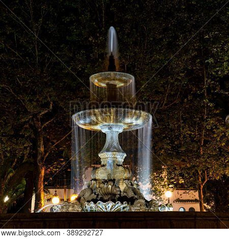 Cordoba, Spain - November 01, 2019: Illuminated Fountain Situated On The Plaza De Colon Square Insid