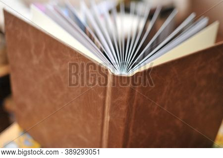 Composition Of Photobooks In Natural Brown Leather . Fragment Of A Photobook Binding