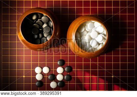 Go Is An Abstract Strategy Board Game For Two Players - Other Names For Go Are: Igo (alternate Japan