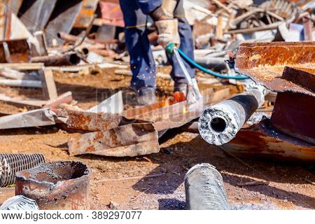 Worker Is Cutting Waste Metal With Gas By Mixing Oxygen And Acetylene, Propane.
