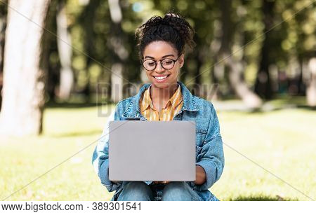 E-learning. African American Female Student Using Laptop Computer Learning Online Browsing Internet